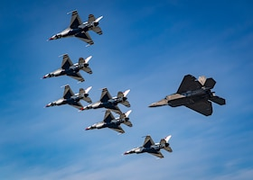 """Thunderbirds"" and F-22 Raptor fly over Lake Michigan"