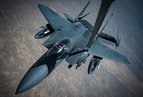 An F-15E Strike Eagle conducts aerial refueling with a KC-10