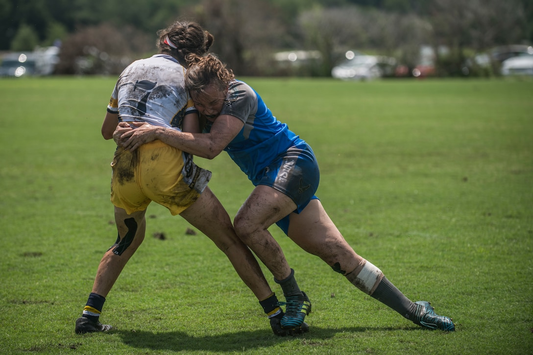A U.S. Air Force rugby player, tackles a Navy rugby player during a tournament