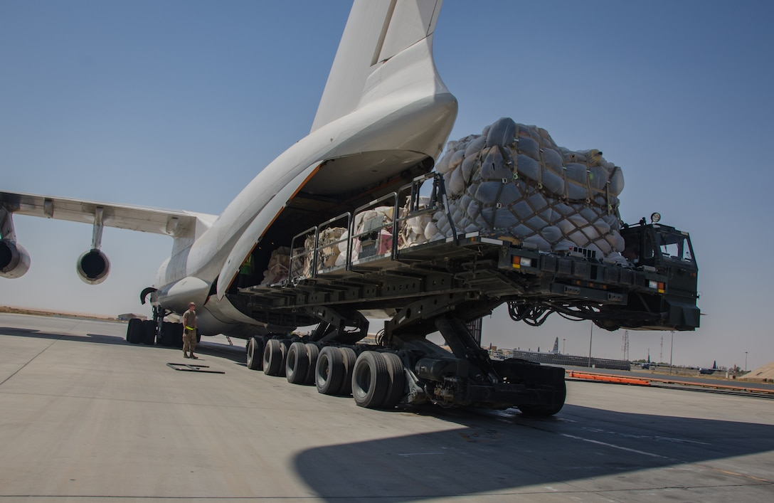 Airmen load a contracted Ilyushin IL-76 aircraft