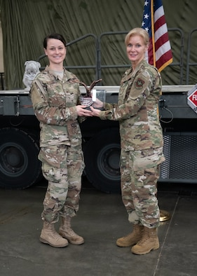 Col. Mary Decker (right), commander of the 123rd Mission Support Group, presents the Chief Master Sgt. Tommy Downs Award for Excellence in Aerial Port Operations to Tech. Sgt. Sarah Meyer during a ceremony at the Kentucky Air National Guard Base in Louisville, Ky., May 19, 2019. Meyer was selected from among more than 1,700 aerial porters as the top transportation journeyman in the Air National Guard for 2018. (U.S. Air National Guard photo by Master Sgt. Vicky Spesard)
