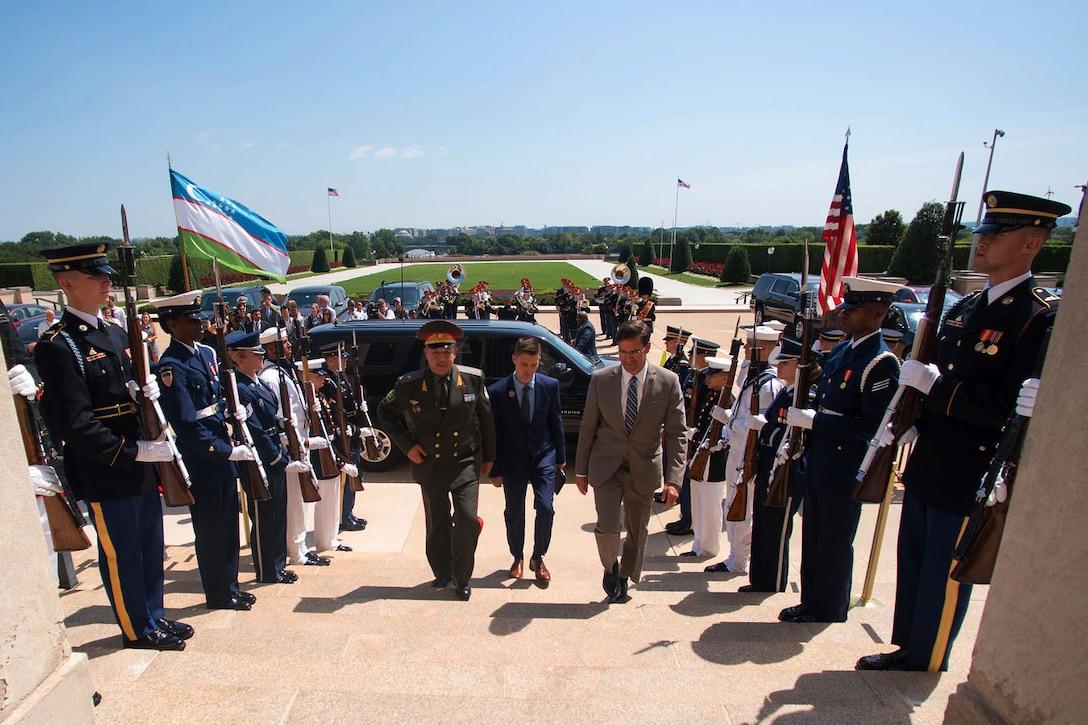 Acting Defense Secretary Dr. Mark T. Esper walks up Pentagon steps with Uzbekistan Defense Minister Bakhodir Kurbanov.