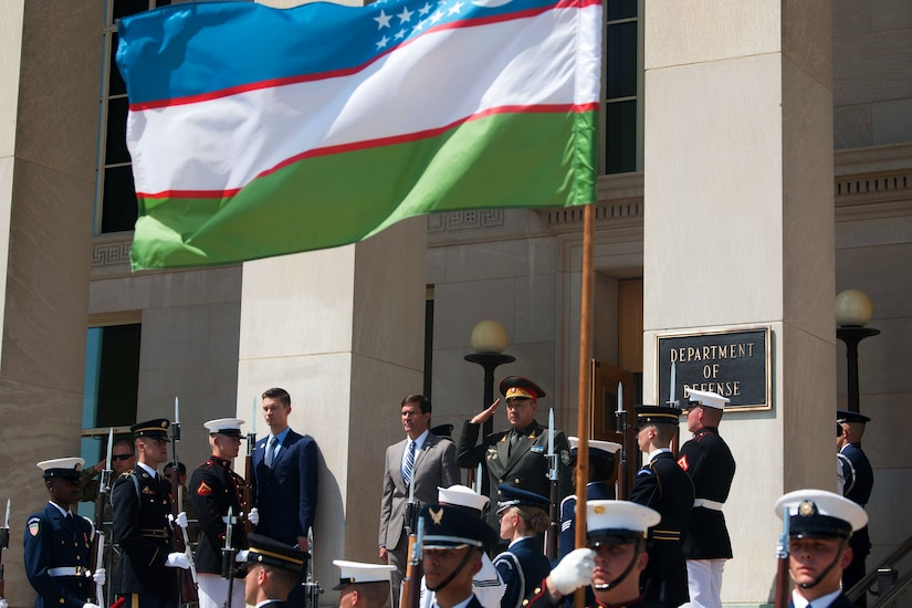 Acting Defense Secretary Dr. Mark T. Esper stands at the top of Pentagon steps with Uzbekistan Defense Minister Bakhodir Kurbanov.