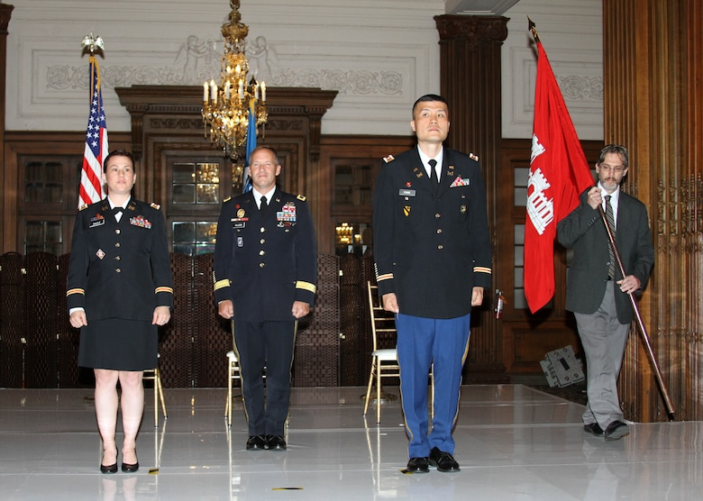 Lt. Col. David C. Park (center-right) assumed command of the USACE Philadelphia District from Lt. Col. Kristen N. Dahle (left) during a July 12, 2019 ceremony in the Wanamaker Building. Maj. Gen. Jeffrey L. Milhorn (left-center), commander of the North Atlantic Division, presided over the ceremony. Deputy District Engineer Nate Barcomb (right) was entrusted with passing the colors as part of the ceremony.