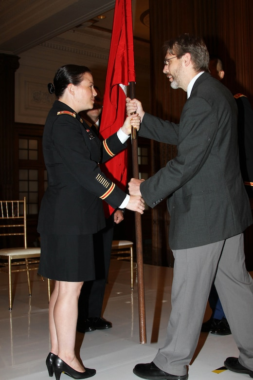 LTC Kristen N. Dahle (left) receives the colors from Deputy District Engineer Nate Barcomb during a July 12, 2019 Change of Command ceremony in the Wanamaker Building. LTC David C Park assumed command of the organization during the ceremony.