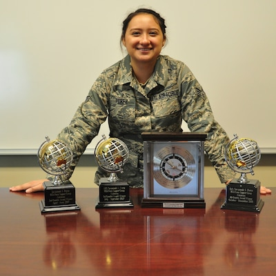Senior Airman Savannah Perez' three Airman of The Quarter Awards (left) and the JBSA Top Paralegal trophy (right) will grow by two soon. (Photo by Brian Lepley)