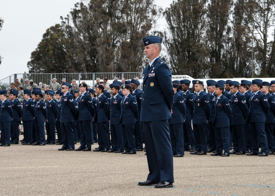 30th Space Wing members participate in a change of command ceremony July 12, 2019, at Vandenberg Air Force Base, Calif. During the ceremony, Col. Anthony J. Mastalir assumed command of the 30th Space Wing and will be in charge of operations for the Western Range, assuring continued access to space. (U.S. Air Force photo by Airman 1st Class Aubree Milks)