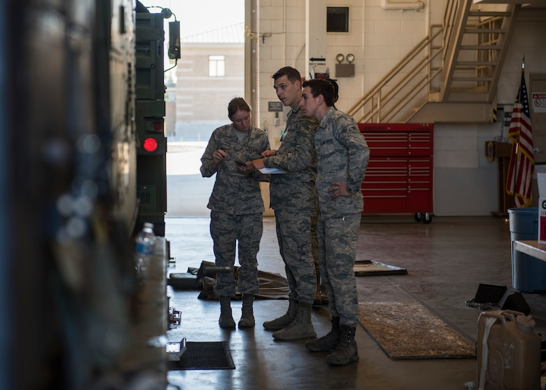 Airman 1st Class Alexis Smith, Airman 1st Class Nicolas Johnson, and Airman 1st Class Joseph Landeros, 726th Air Control Squadron, conduct a weight inspection on a Medium Tactical Vehicle in preparation for a 726th ACS deployment exercise July 11, 2019, at Mountiain Home Air Force Base, Idaho. Thier role during the exercise is to make sure the MTVs adhere to all weight regulations. (U.S. Air Force photo by Senior Airman Tyrell Hall)