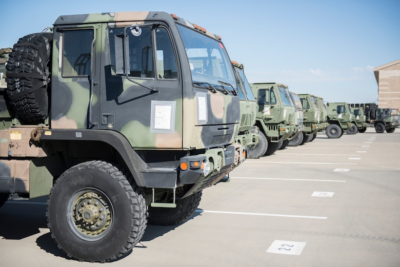 Medium Tactical Vehicles line up in preparation for a 726th Air Control Squadron exercise July 11, 2019, at Mountain Home Air Force Base, Idaho. The vehicles are parked ready to leave from MHAFB in a convoy during the exercise. (U.S Air Force Photo by Senior Airman Tyrell Hall)