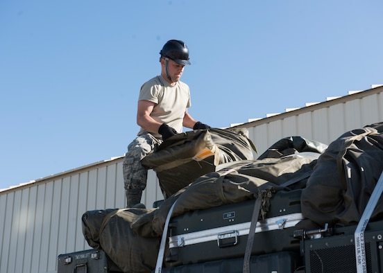 SrA Jordan Jones, 726th Air Control Squadron, loads equipment onto a Medium Tactical Vehicle July 11, 2019, at Mountain Home Air Force Base, Idaho. The cargo is being loaded in preparation for a 726th ACS deployment exercise. (U.S. Air Force Photo by Senior Airman Tyrell Hall)