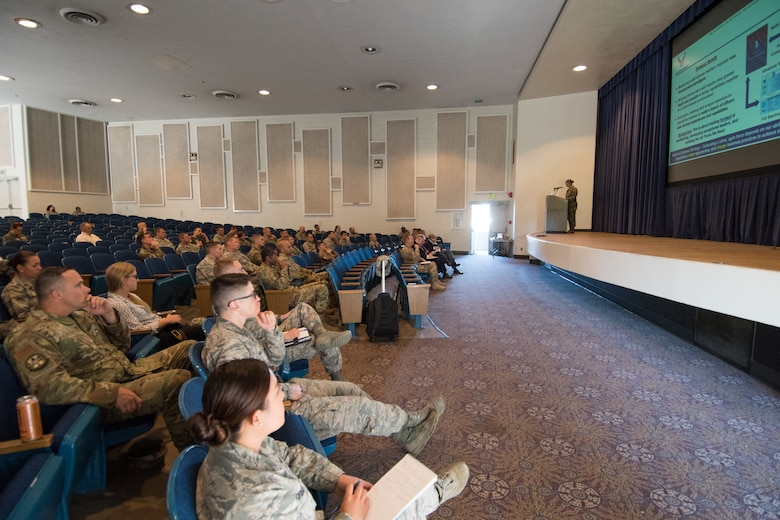 Airmen listen to the Line of the Air Force Promotion Category Configuration brief during the Assistant Secretary of the Air Force Manpower and Reserve Affairs team visit to Peterson Air Force Base, Colorado, July 9, 2019. Airmen are encouraged to either attend one of the SAF/MR visits at their respective base or go online for more information: https://mypers.af.mil/app/answers/detail/a_id/43326.