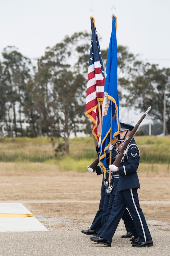 30th Space Wing members participate in a change of command ceremony July 12, 2019, at Vandenberg Air Force Base, Calif. During the ceremony, Col. Anthony J. Mastalir assumed command of the 30th Space Wing and will be in charge of operations for the Western Range, assuring continued access to space. (U.S. Air Force photo by Airman 1st Class Hanah Abercrombie)