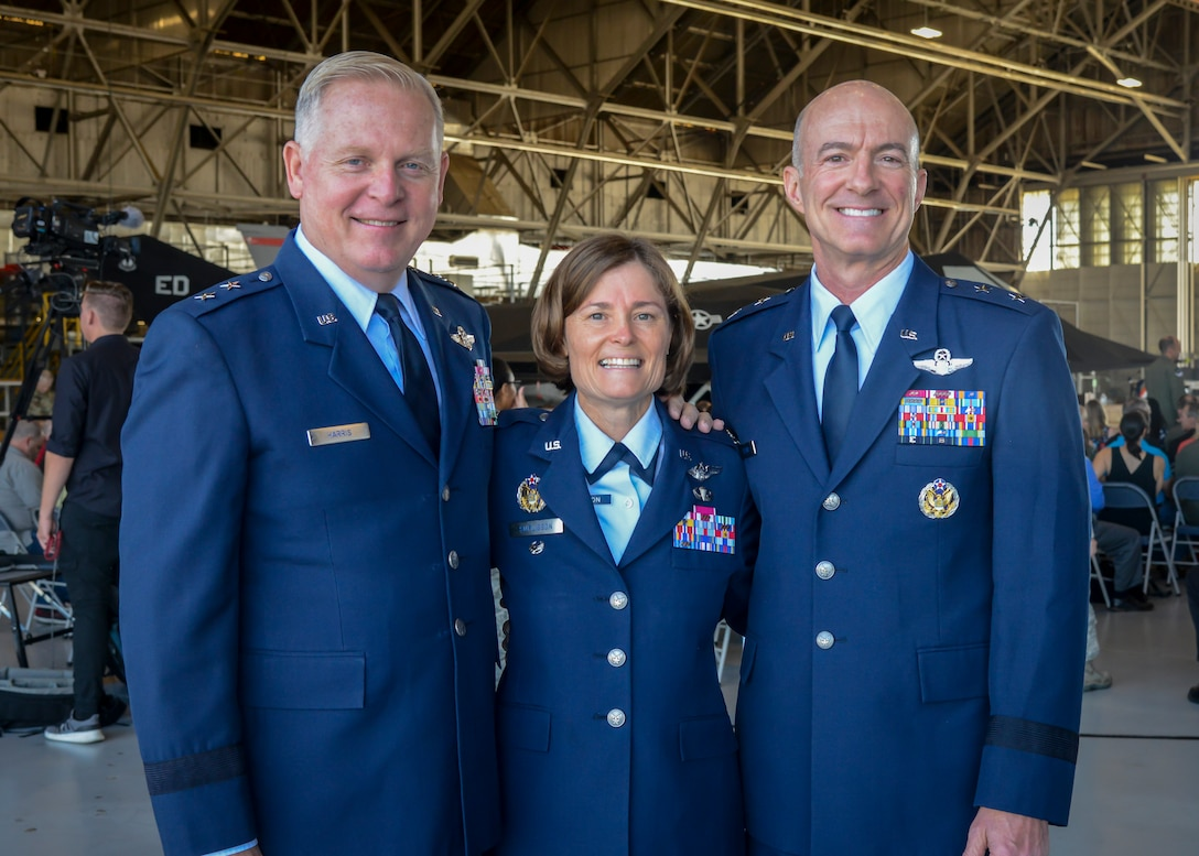 Maj. Gen. (Retired) David Harris, former AFTC Commander, Col. Angela Suplisson, Air Force Test Center Vice Commander,  and Maj. Gen. Christopher Azzano, AFTC Commander, pose for a photo prior to Suplisson's retirement ceremony at Edwards Air Force Base, California, July 12. (U.S. Air Force photo by Giancarlo Casem)