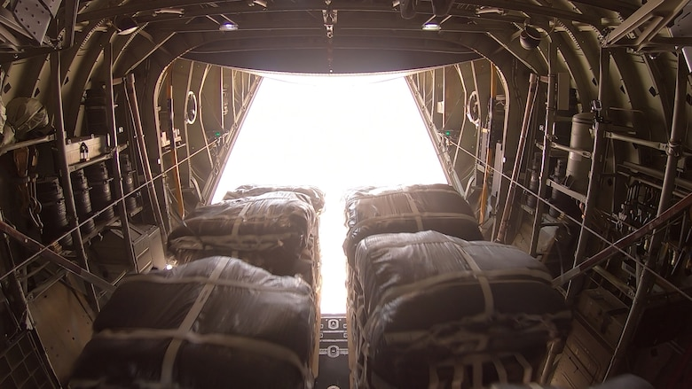Airmen of the 746th and 816th Expeditionary Airlift Squadrons conduct the largest sustainment airdrop in the area of responsibility's history July 11, 2019. An airdrop is a delivery method used to provide vital supplies to service members in remote or combat locations. (U.S. Air Force photo)