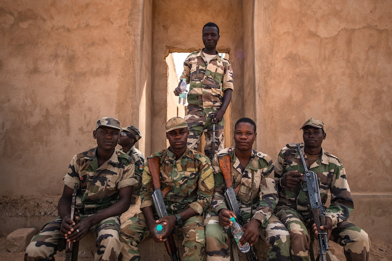 Niger Armed Forces (French language: Forces Armées Nigeriennes) members take a break during a training exercise with the 409th Expeditionary Security Forces Squadron air advisors at the FAN compound on Nigerien Air Base 201 in Agadez, Niger, July 10, 2019. The air advisors train the FAN on a daily basis, increasing their readiness and improving interoperability. (U.S. Air Force photo by Staff Sgt. Devin Boyer)