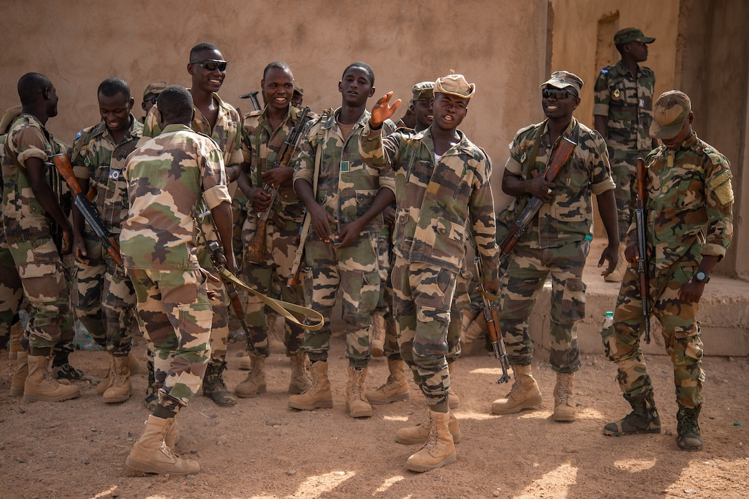 Niger Armed Forces (French language: Forces Armées Nigeriennes) members sing and dance while on break during a training exercise with the 409th Expeditionary Security Forces Squadron air advisors at the FAN compound on Nigerien Air Base 201 in Agadez, Niger, July 10, 2019. The FAN sing and dance every training day to keep their morale high. (U.S. Air Force photo by Staff Sgt. Devin Boyer)
