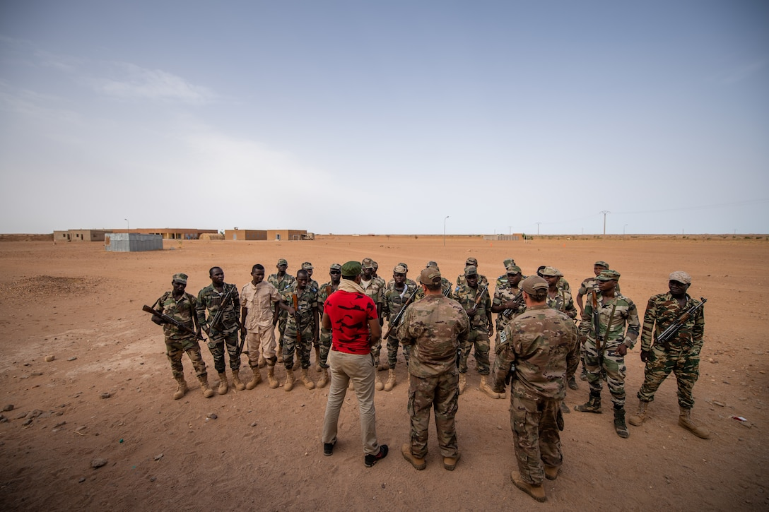 U.S. Air Force air advisors assigned to the 409th Expeditionary Security Forces Squadron brief the Niger Armed Forces (French language: Forces Armées Nigeriennes) before training exercises at the FAN compound on Nigerien Air Base 201 in Agadez, Niger, July 10, 2019. The FAN learned how to efficiently and safely clear a building. (U.S. Air Force photo by Staff Sgt. Devin Boyer)