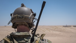 A Tactical Air Control Support (TACP) Specialist Airman with the 820th Expeditionary Air Support Operations Squadron, surveys the landscape during medical evacuation training at Camp Buehring, Kuwait, July 12, 2019. Airmen from the 386th Expeditionary Medical Group, stationed at Ali Al Salem Air Base, Kuwait, trained with TACP's to become more efficient at treating injuries and coordinating medevac efforts for casualties. (U.S. Air Force photo by Tech. Sgt. Daniel Martinez)
