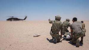 Tactical Air Control Support (TACP) Airmen with the 820th Expeditionary Air Support Operations Squadron, exericse a medical evacuation scenario with Airmen from the 386th Expeditionary Medical Group during a training scenario at Camp Buehring, Kuwait, July 12, 2019. Medical and TACP Airmen trained together to hone their skills and become more efficient at treating injuries and coordinating medevac efforts for casualties. (U.S. Air Force photo by Tech. Sgt. Daniel Martinez)
