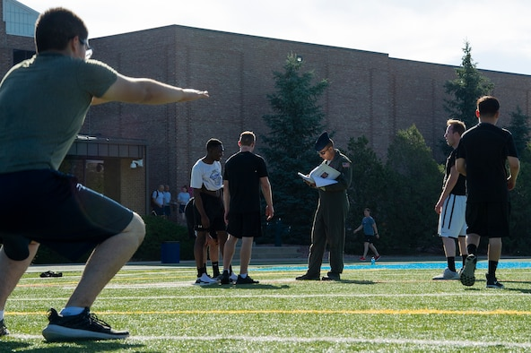 Tech. Sgt. Joshua Winn, 302nd Airlift Wing Development and Training Flight program manager, supervises trainees during group physical fitness training July 14, 2019 at Peterson Air Force Base, Colorado. The D&TF program is designed to prepare future Reserve Citizen Airmen for Air Force basic military training. (U.S. Air Force photo by Tech. Sgt. Amber Sorsek)