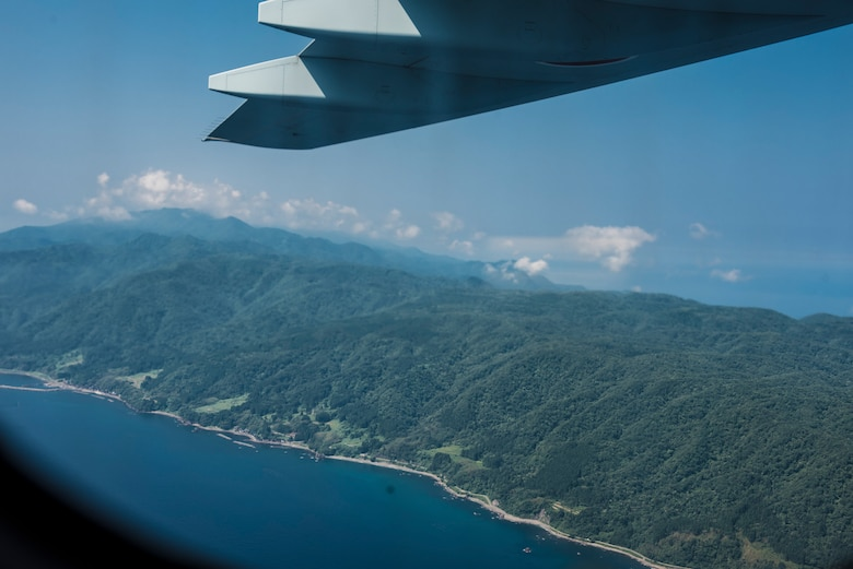 The view from the inside of a C-2 assigned to Japan Air Self-Defense Force, 3rd Tactical Airlift Wing, 403rd Squadron, as it flies over Sado island, Japan, during a bilateral airlift exchange July 10, 2019.