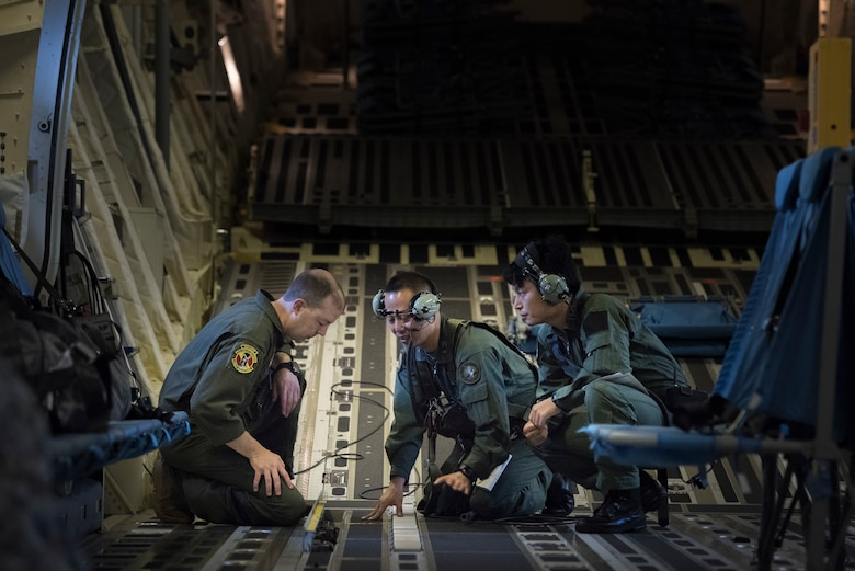 A members from the Japan Air Self-Defense Force answer questions from Master Sgt. Michael McArty, 36th Airlift Squadron flight chief and C-130J evaluator, during a bilateral airlift exchange over Chubu region, Japan, July 10, 2019.