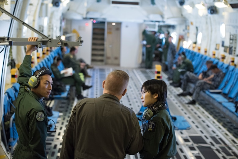 Master Sgt. James Huntsman, 36th Airlift Squadron flight chief and C-130J instructor loadmaster, converses with aircrew members from Japan Air Self-Defense Force during a bilateral airlift exchange over Chubu region, Japan, July 10, 2019.
