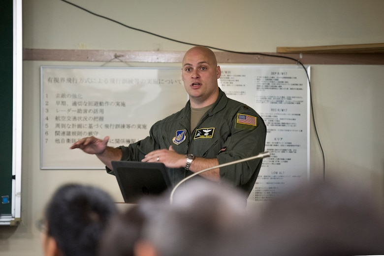Major Christopher Wolff, 36th Airlift Squadron assistant director of operations, briefs members of the Japan Air Self-Defense Force during a bilateral airlift exchange at Iruma Air Base, Japan, July 10, 2019.