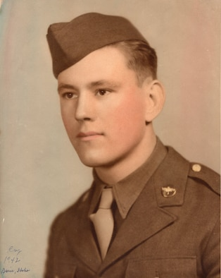 Dewey Christopher, now a retired master sergeant and veteran of World War II and the 100th Bombardment Group and 351st Bomb Squadron, poses for his official photo in his Class A uniform in 1942. Christopher was a crew chief with the 100th Bombardment Group and 351st Bomb Squadron at Thorpe Abbotts, Diss, England, during World War II. He visited RAF Mildenhall in June 2019, when the Professional Development Center was renamed in his honor, and while here shared stories from his military days. (Courtesy photo)