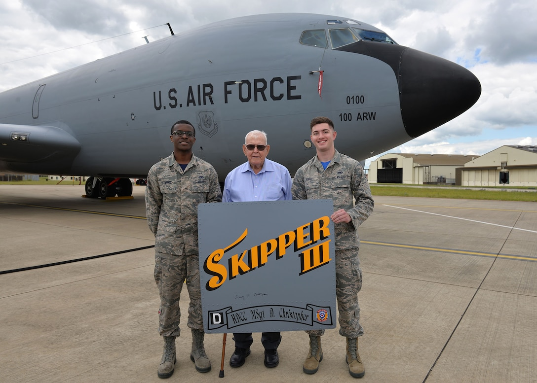 U.S. Air Force Airman 1st Class Isaiah Herring, left, 100th Aircraft Maintenance Squadron maintainer, and U.S. Air Force Airman Camden Roman, 100th Maintenance Squadron maintainer, pose for a photo with retired Master Sgt. Dewey Christopher, a former 351st Bomb Squadron crew chief, 100th Bomb Group and World War II veteran, during the veteran's visit to RAF Mildenhall, England, June 21, 2019. Christopher visited the base to attend a renaming ceremony of the Professional Development Center in his honor. (U.S. Air Force photo by Karen Abeyasekere)