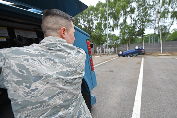 U.S. Air Force Airman 1st Class Louis Goscha, 48th Logistics Readiness Squadron ground transportation operator, flips a car using a tow truck during a Readiness Honed In Operations training day at RAF Lakenheath, England, July 13, 2019. The training was the first dual-wing RHINO training day for ground transportation Airmen that encompassed expeditionary, contingency and specialty skills training such as basic expeditionary airfield resources base setup, integrated defense and vehicle recovery. (U.S. Air Force photo by Senior Airman Luke Milano)