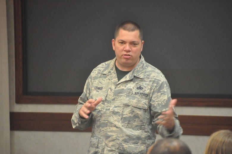 Operations Training and Procedures manager for the Flight Standards Agency, Master Sgt. Timothy Lenker, discusses how he became involved in teaching suicide prevention classes with the Wingman Day audience on June 21 in the Air Force Sustainment Center Anaconda Room. (U.S. Air Force photos/Megan Prather)