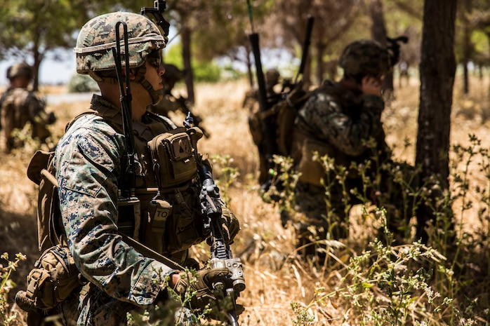 A U.S. Marine with Special Purpose Marine Air-Ground Task Force-Crisis Response-Africa 19.2, Marine Forces Europe and Africa, posts security during a tactical recovery of aircraft and personnel mission rehearsal on Moron Air Base, Spain, July 2, 2019.