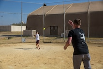 A U.S. Marine with Special Purpose Marine Air-Ground Task Force-Crisis Response-Africa 19.2, Marine Forces Europe and Africa, plays baseball with a student from La Inmaculada charter school during a community relations event on Moron Air Base, Spain, July 2, 2019.