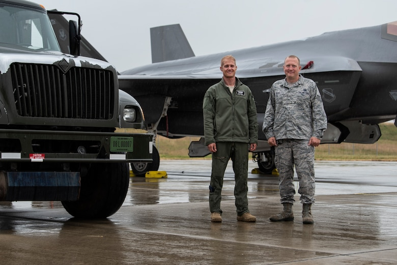 U.S. Air Force Maj. Michael Slotten, 421st Fighter Squadron F-35A Lightning II pilot, left, poses for a photo with his former shift supervisor, Tech. Sgt. Charles Moore, 52nd Logistics Readiness Squadron fuels distribution NCO in charge, right, at Spangdahlem Air Base, Germany, July 11, 2019. Slotten was stationed at Spangdahlem from 2004 to 2006 as an Airman first class fuels distributor operator. He reunited with Moore, who is currently stationed at Spangdahlem again. (U.S. Air Force photo by Airman 1st Class Valerie Seelye)