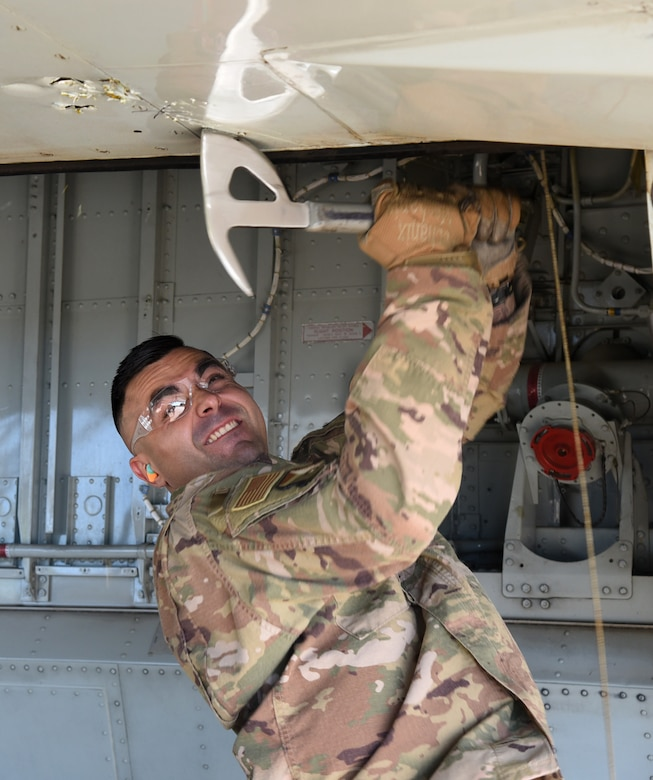 Staff Sgt. Skyler McInnis, an expeditionary depot maintenance craftsman with the 76th Aircraft Maintenance Group, creates the first damage to Speckled Trout, a KC-135 that was once used to transport DV's. (U.S. Air Force photo/Kelly White)