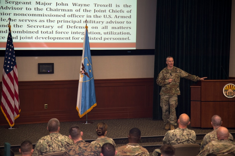 U.S. Army Command Sgt. Maj. John W. Troxell, senior enlisted advisor to the chairman of the Joint Chiefs of Staff, speaks during a joint force NCO all call, July 11, 2019, at MacDill Air Force Base, Fla. Troxell spoke about the people of the enlisted force, and how they provide the U.S. Military with the greatest war fighting advantage. (U.S. Air Force photo by Airman 1st Class Shannon Bowman)