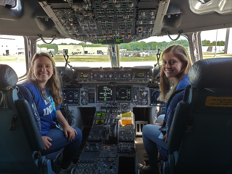 Premier College Intern Program interns Sarah Earnesty and Kayleigh Brown explore the cockpit of a C-17 during part of their three-day symposium at Wright-Patterson Air Force Base. The symposium was hosted by the Air Force Personnel Center at the Holiday Inn in Fairborn, Ohio, June 25-27.  (U.S. Air Force photo/Karina Brady)