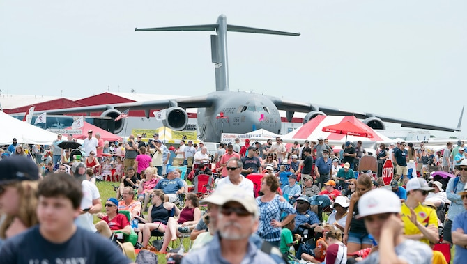 "A U.S. Air Force C-17 Globemaster III cargo plane belonging to the 445th Airlift Wing serves as a backdrop to some of the thousands of spectators waiting for a chance to see the USAF Air Demonstration Squadron ""Thunderbirds"" fly June 23, 2019, at the Vectren Dayton Air Show. The 445th AW is an Air Force Reserve wing stationed at the nearby Wright-Patterson Air Force Base, Ohio."