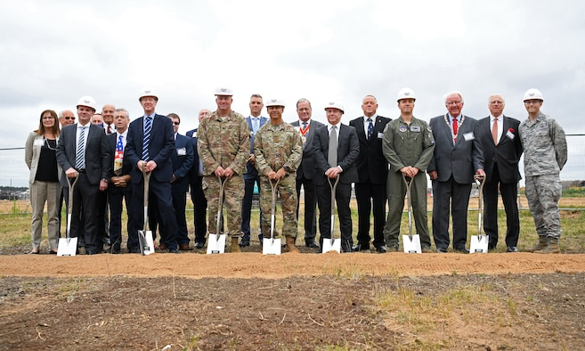 General Jeffrey L. Harrigian, U.S. Air Forces in Europe and Air Forces Africa commander, (center), poses for a photo with 48th Fighter Wing personnel and local civic leaders, partners and contractors during an F-35 groundbreaking ceremony at RAF Lakenheath, England, July 15, 2019. Through the partnership with the Defence Infrastructure Organisation, as well as Kier and VolkerFitzpatrick construction groups, the installation will be ready to welcome the first F-35A Lightning II aircraft in late 2021. (U.S. Air Force photo by Airman 1st Class Shanice Williams-Jones)