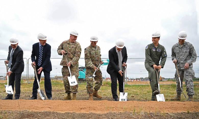 General Jeffrey L. Harrigian, U.S. Air Forces in Europe and Air Forces Africa commander, (center), poses for a photo with 48th Fighter Wing personnel and local civic leaders, partners and contractors during an F-35 groundbreaking ceremony at RAF Lakenheath, England, July 15, 2019. The groundbreaking follows the ongoing construction projects that will facilitate two F-35A Lighting II squadrons, making RAF Lakenheath the first permanent international site for U.S. fifth generation aircraft in Europe. (U.S. Air Force photo by Airman 1st Class Shanice Williams-Jones)