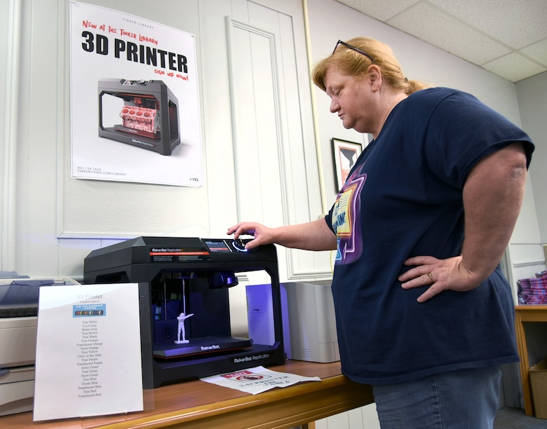 Carla Tubby, a library technician with the 72nd Force Support Squadron, adjusts the settings on the Tinker Library's new 3D printer which is available for use during normal library hours. For more information or to make an appointment to use the printer, please call (405)734-2626. (U.S. Air Force photo/Kelly White)