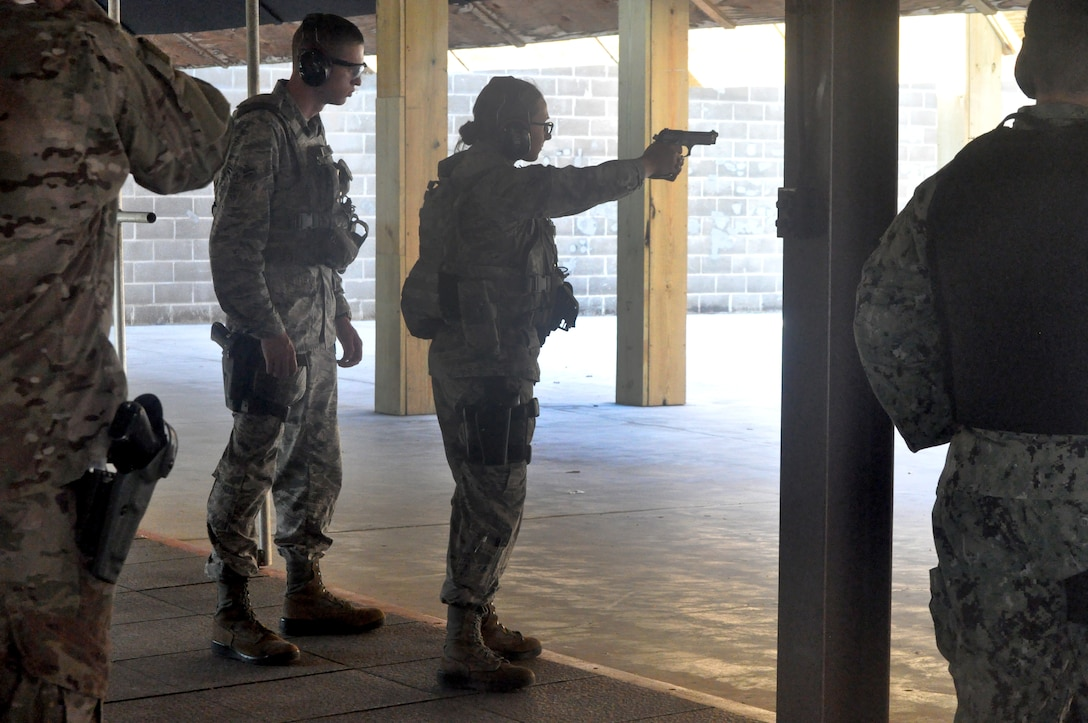 Airman 1st Class Jessica Clemens fires at a target during a pistol carbine course at the CATM range last week. The course was part of the advanced training conducted by active duty and Air Force Civilian Police Officers of the 72nd Security Forces Squadron. The course also certified them as Range Safety Officers with the National Rifle Association.