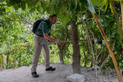 U.S. Army Capt. Patrick McClellan, Joint Task Force – Bravo Medical Element entomologist, vacuums insects that could serve as disease vectors during a Leishmaniasis investigation July 9, 2019, at La Libertad, Honduras. Members of JTF-B were asked by the Honduran Ministry of Health to conduct an investigation into the cause of Leishmaniasis and provide any recommendations that may stop infection. Leishmaniasis is a parasitic disease that is caused by infection with leishmania parasites, which are spread through the bite of sand flies. (U.S. Air Force photo by Staff Sgt. Eric Summers Jr.)
