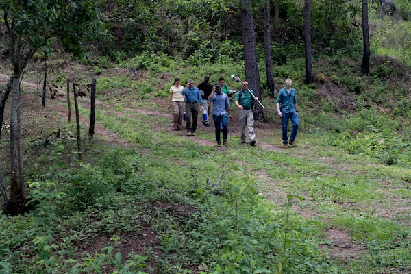 U.S. Army medical personnel traverse through mountains to visit homes of possible Leishamaniasis patients during an investigation July 9, 2019, at La Libertad, Honduras. Members of JTF-B were asked by the Honduran Ministry of Health to conduct an investigation into the cause of Leishmaniasis and provide any recommendations that may stop infection. Leishmaniasis is a parasitic disease that is caused by infection with leishmania parasites, which are spread through the bite of sand flies. (U.S. Air Force photo by Staff Sgt. Eric Summers Jr.)