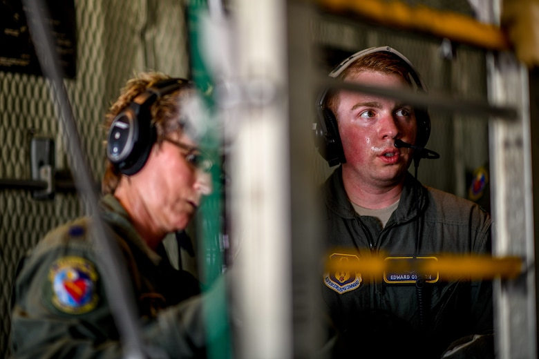 1st Lt. Edward Osborn, a Reserve Citizen Airman with the 445th Aeromedical Evacuation Squadron, communicates with medical personnel aboard a Youngstown Air Reserve Station C-130H Hercules on July 10, 2019, on the flightline at Wright-Patterson Air Force Base.