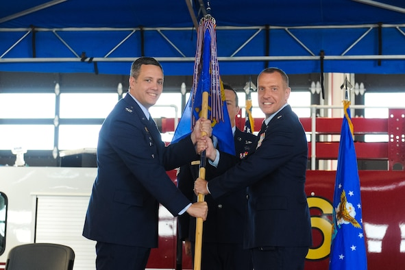 Col. Edward Marshall, 45th Mission Support Group commander, presents Lt. Col. Joshua Connell, incoming 45th Civil Engineering Squadron commander, with the 45th CES guidon as he assumes command of the group. (U.S. Air Force photo by Amanda Ryrholm)