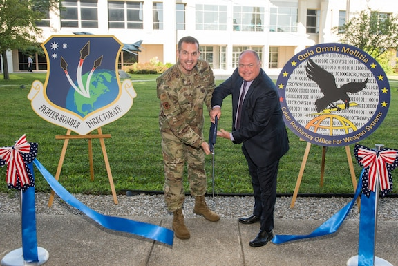 Brig. Gen. Heath Collins, Fighters and Bombers, program executive officer and Joseph Bradley, CROWS director, officially open a cyber defense facility July 9, 2019 at Wright-Patterson Air Force Base, Ohio, for the Air Force Life Cycle Management Center's Fighters and Bombers Directorate. (U.S. Air Force photo by Wesley Farnsworth)