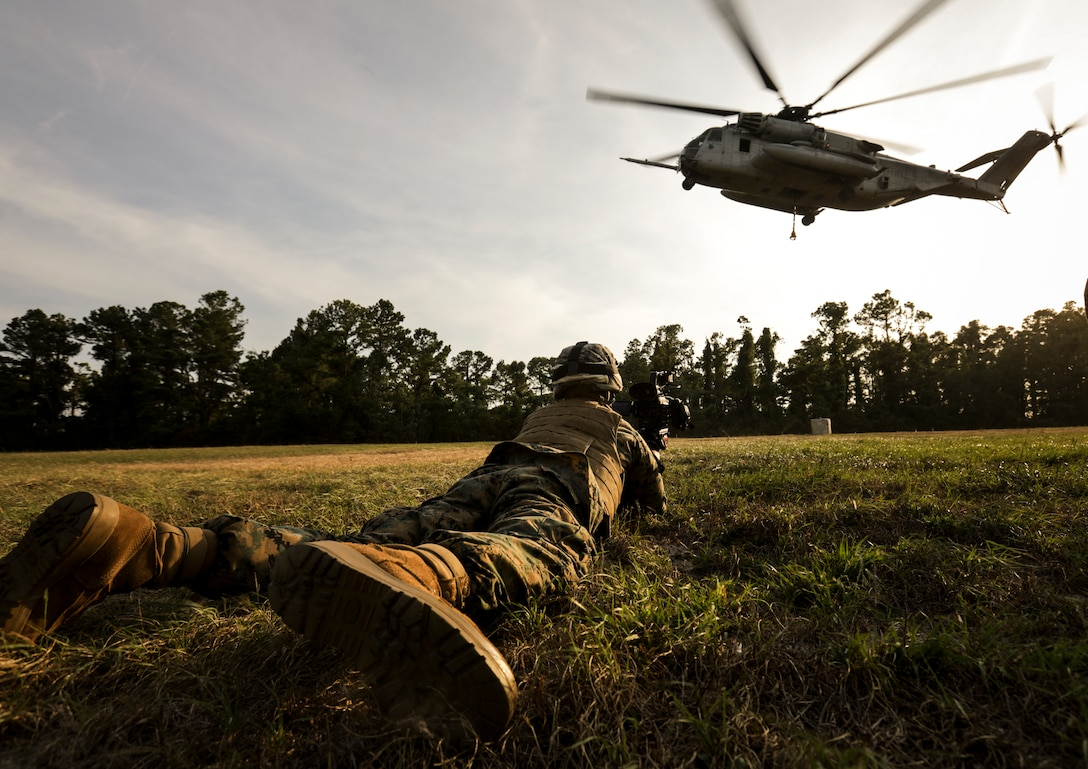 U.S. Marine Corps Lance Cpl. Nikolas E. Arcelaynolan, a combat videographer with Headquarters and Serice Company, Marine Corps Combat Service Support Schools, documents a CH-53E Super Stallion conducting helicopter support teams exercise at Landing Zone Kite, on Camp Lejeune, N.C., July 1, 2019. Lance Cpl. Arcelaynolan documented entry level Marines conducting HST exercises.