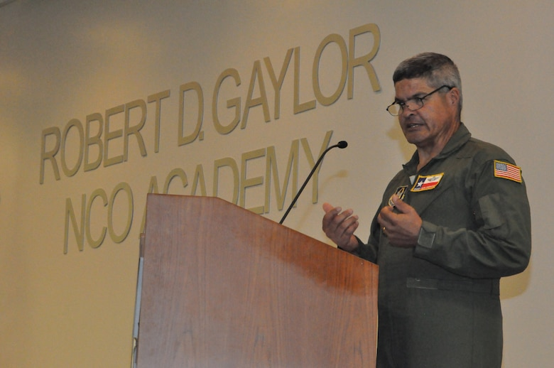 Chief Master Sgt. Mark Sherwood, 356th Airlift Squadron, speaks at the noncommissioned officer induction ceremony held July 13, 2019 at the Robert D. Gaylor NCO Academy, Joint Base San Antonio-Lackland, Texas.
